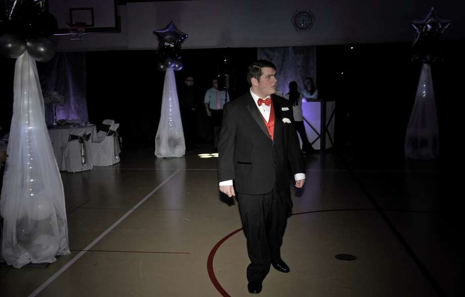 "Michael Vitti, of Brookfield,, attended ""Night to Shine"", a prom for people with special needs, ready for Valentines Day with a red bow tie and vest. The event, sponsored by the Tim Tebow Foundation was hosted by Faith Church, of New Milford,  on Friday night, February 13, 2015, in New Milford, Conn. The evening of prom style dining and dancing was one of 44 held in participating churches across the country on Friday night. Photo: H John Voorhees III / The News-Times"