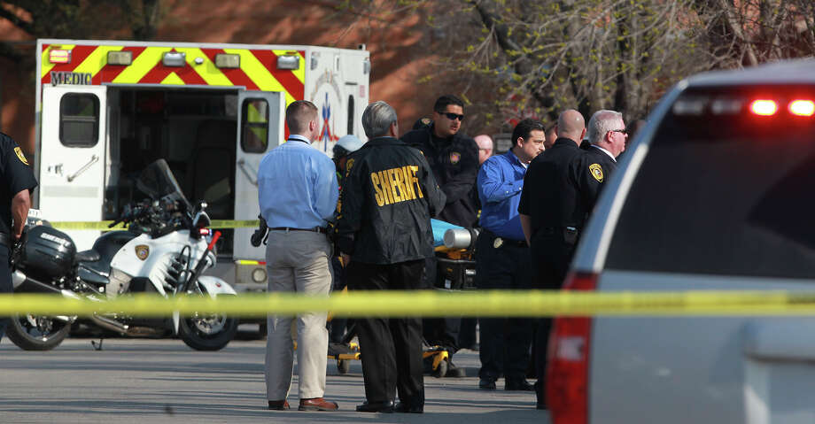 San Antonio EMS arrives Friday at the scene of a shooting near Rosillo and West Martin streets. A  suspect  was shot by Bexar County deputies. Photo: JOHN DAVENPORT /San Antonio Express-News / ©San Antonio Express-News/John Davenport