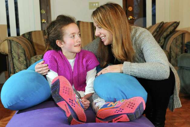 Hannah Sames, 10, left, and her mother, Lori Sames, at their home on Friday, Feb. 13, 2015, in Clifton Park, N.Y. (Cindy Schultz / Times Union) Photo: Cindy Schultz / 00030620A