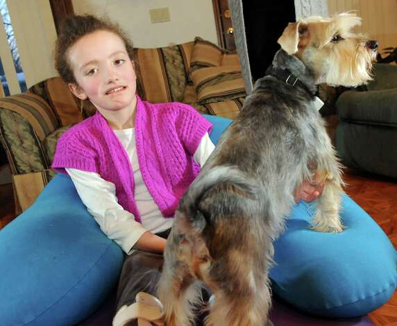 Hannah Sames, 10, with her dog Jake at her home on Friday, Feb. 13, 2015, in Clifton Park, N.Y. (Cindy Schultz / Times Union) Photo: Cindy Schultz / 00030620A