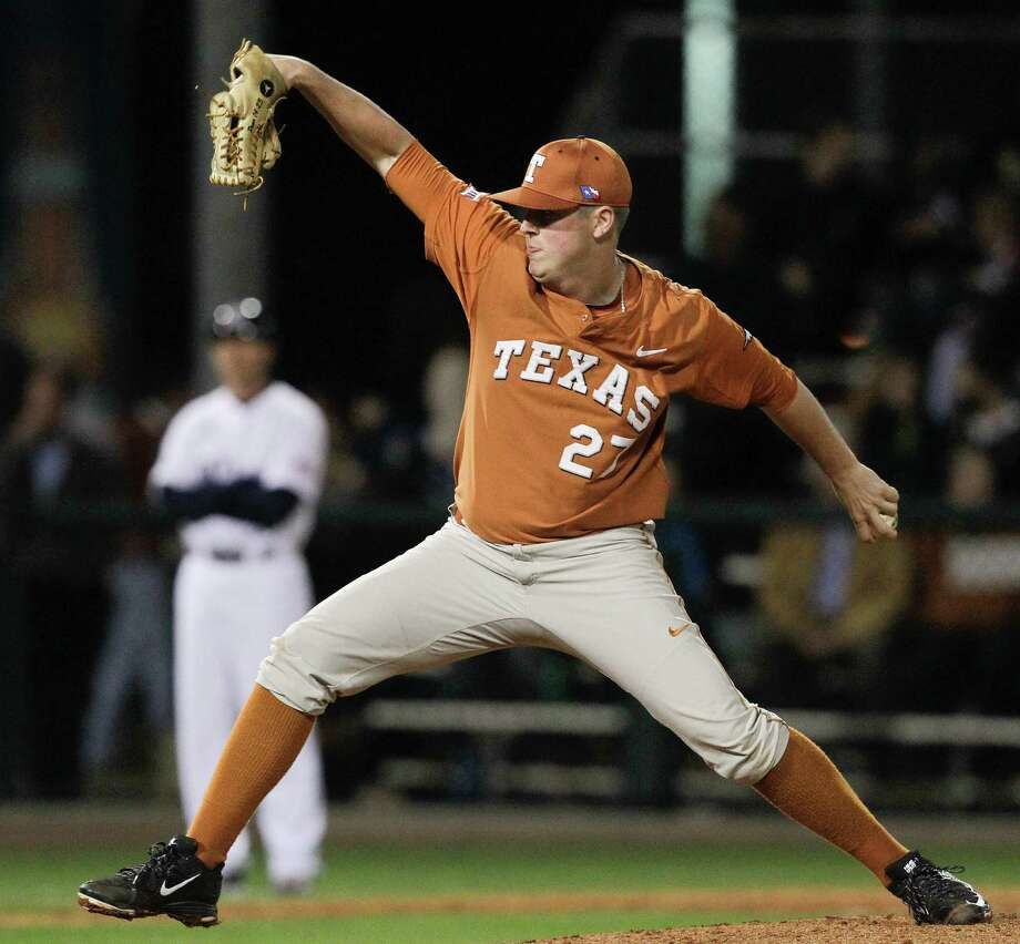 Texas reliever Travis Duke effectively sidestepped potential scoring rallies by Rice to earn a victory in the season opener Friday night at Reckling Park. Photo: Bob Levey, For The Chronicle / ©2015 Bob Levey