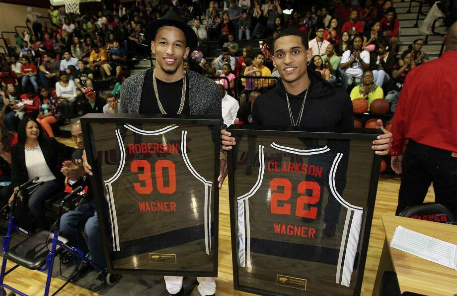 Former Wagner basketball standouts Jordan Clarkson (right) and Andre Roberson (left) hold their framed jerseys as they were honored before a game between Clemens and Wagner at Wagner on Feb. 13, 2015. Photo: Kin Man Hui /San Antonio Express-News / ©2015 San Antonio Express-News