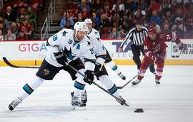 GLENDALE, AZ - FEBRUARY 13:  Joe Thornton #19 of the San Jose Sharks skates with the puck during the second period of the NHL game against the Arizona Coyotes at Gila River Arena on February 13, 2015 in Glendale, Arizona.  (Photo by Christian Petersen/Getty Images)
