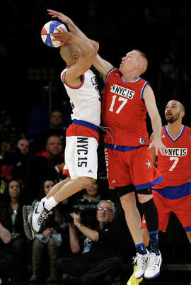 Chris Mullin, age 51, defends against rapper Common in celebrity game.