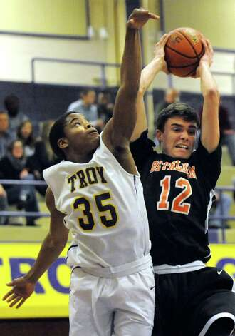 Bethlehem's John Sica, right, wins the rebound over Troy's Nyjere Pugh during their basketball game on Friday, Feb. 13, 2015, at Troy High in Troy, N.Y. (Cindy Schultz / Times Union) Photo: Cindy Schultz / 00030594A
