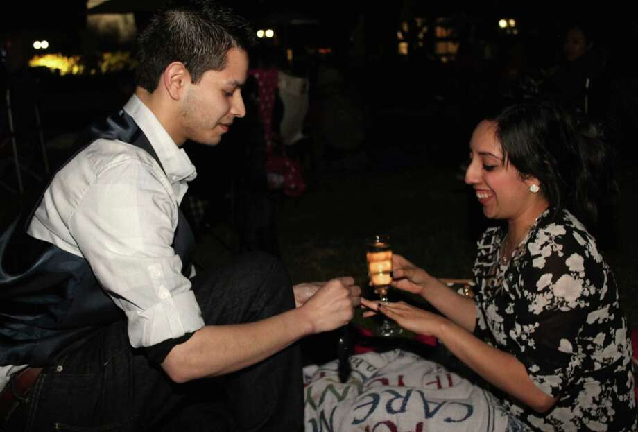 "A special Valentine's edition of ""Movies by Moonlight"" at Travis Park on Friday, Feb. 13, 2015, included music, food trucks, cocktails, a screening of ""Sleepless in Seattle,"" lots of couples and even a marriage proposal. Photo: Yvonne Zamora/For The Express-News"