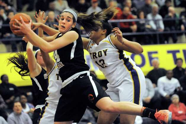 Bethlehem's Gabby Giacone, center, wins the rebound during their their basketball game against Troy on Friday, Feb. 13, 2015, at Troy High in Troy, N.Y. (Cindy Schultz / Times Union) Photo: Cindy Schultz / 00030593A