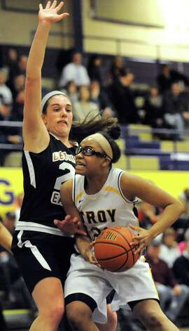 Troy's Alliyah Gillespie, right, looks to the hoop as Bethlehem's Gabby Giacone defends during their their basketball game on Friday, Feb. 13, 2015, at Troy High in Troy, N.Y. (Cindy Schultz / Times Union) Photo: Cindy Schultz / 00030593A
