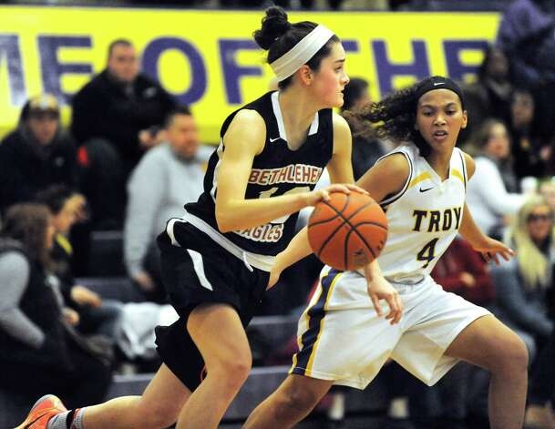 Bethlehem's Jenna Giacone, left, drives up court as Troy's Kianna Patterson defends during their their basketball game on Friday, Feb. 13, 2015, at Troy High in Troy, N.Y. (Cindy Schultz / Times Union) Photo: Cindy Schultz / 00030593A