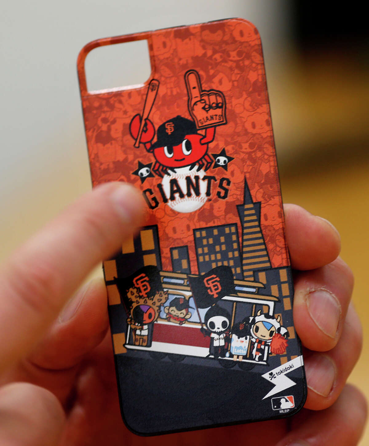 A company called Tokidoki was able to create a smartphone case with the Giants logos and some original design using the Coveroo product.