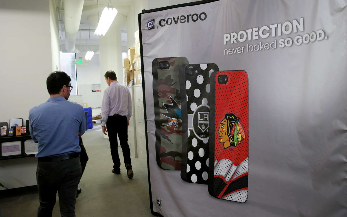 Coveroo executives walk through the company's San Francisco offices, which displays several designs.
