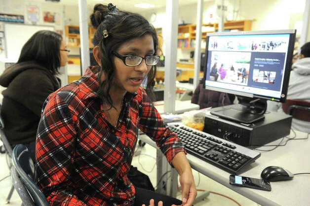 Schenectady High School senior student Salma Shameem works on the computer during an art class on Thursday Feb. 5, 2015 in Schenectady , N.Y.  (Michael P. Farrell/Times Union) Photo: Michael P. Farrell / 00030450A