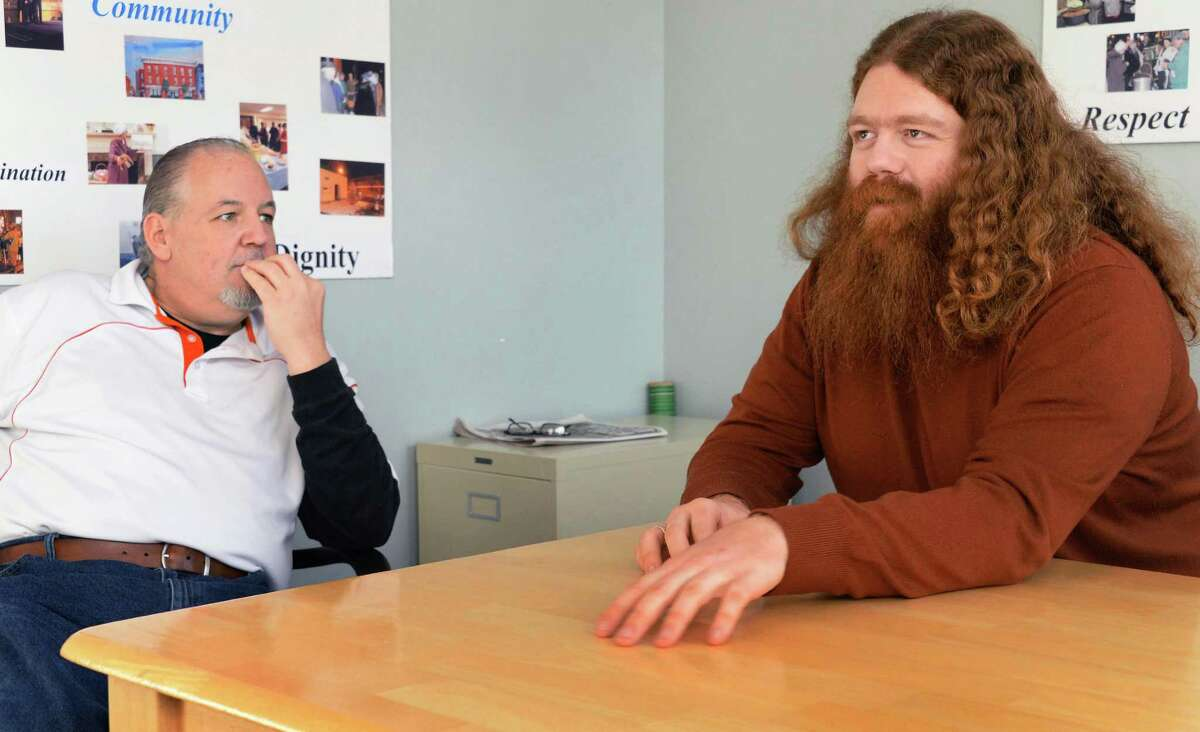 Michael Callahan, left, and Anasha Cummings recall Callahan's suicide attempt last September during an interview at the Hill Street Inn Thursday Feb. 5, 2015 in Troy, NY. It was the first time they had seen each other since Cummings and his friend Duncan Crary saved Callahan's life after a suicide attempt last September. (John Carl D'Annibale / Times Union)