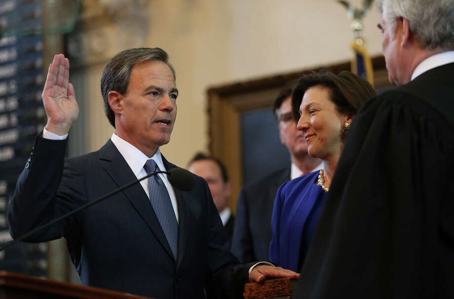 Joe Straus was sworn into office this year for his fourth term as Speaker of the House on Jan. 13, with his wife Julie holding the family Bible. Straus is a rare creature in Texas politics, a level-headed, old-school conservative. Photo: Tom Reel