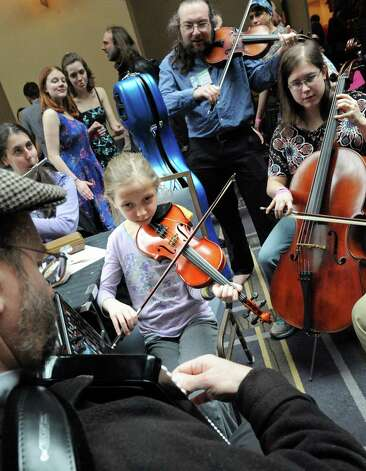 Ten-year-old Malka Traub Pomerantz of Lexington, Mass, center, plays with other musicians in an impromptu jam session during the 2015 Saratoga Dance Flurry at the Saratoga City Center on Saturday Feb. 14, 2015 in Saratoga Springs, N.Y. (Michael P. Farrell/Times Union) Photo: Michael P. Farrell / 00030601A