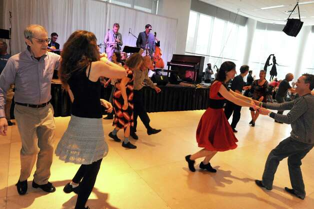 Professor Cunningham and His Old School perform as dancers swing during the 2015 Saratoga Dance Flurry at the Saratoga City Center on Saturday Feb. 14, 2015 in Saratoga Springs, N.Y. (Michael P. Farrell/Times Union) Photo: Michael P. Farrell / 00030601A