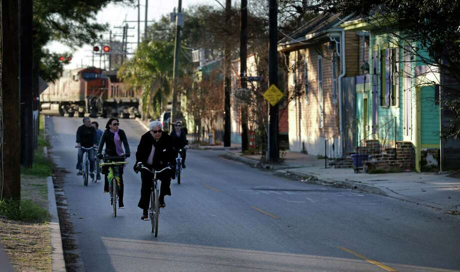 Cyclists ride along Chartres St. near the Mississippi River waterfront in the Bywater section of New Orleans. Zoning proposals could bring major changes to the Bywater area and other neighborhoods near the Mississippi River. Photo: Gerald Herbert, STF / AP