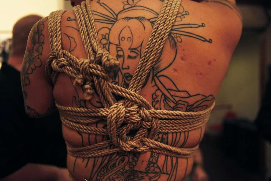 Tarah Una shows off Marshall Bradford's knot work during On the Edge 5: Erotic Art Exhibition at SOMArts in San Francisco, Calif. Friday, February 13, 2015. Photo: Jessica Christian, The Chronicle