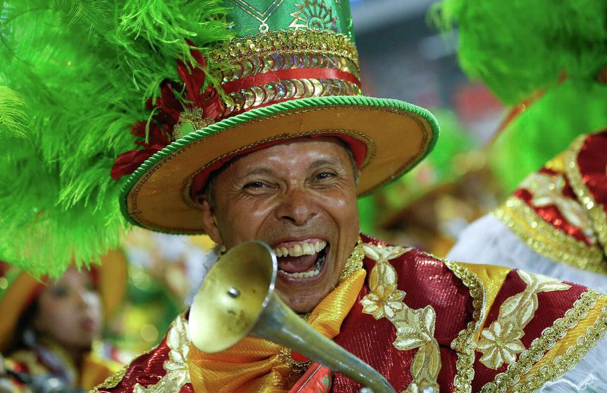 A musician from the Academicos do Tucuruvi samba school performs during the Carnival parade at the Sambodromo in Sao Paulo, Brazil, Friday, Feb. 13, 2015.