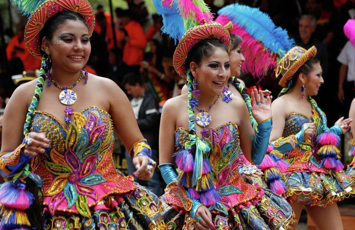 Morenada dancers perform during the carnival celebrations in Oruro, Bolivia, Saturday Feb. 14, 2015. Next to Rio de Janeiro, the mountain mining town is host to one of the largest carnivals in South America with with a participation of thousands dancers and hundreds marching bands.