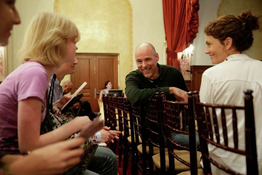 Humanist chaplain Bart Campolo (center), and his wife, Marty (right), mingle with students as they wait for the start of a forum at the University of Southern California. Photo: Jae C. Hong /Associated Press / AP