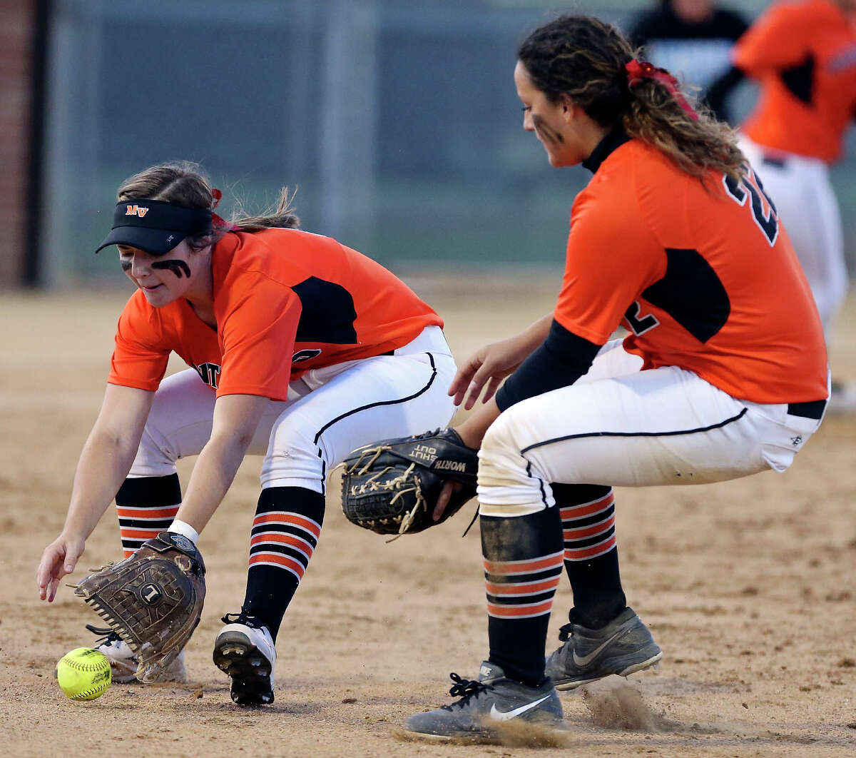 Medina Valley junior pitcher KyLee DeCock (left) and senior first baseman Melinda Parish helped the Panthers to a 38-4 record last season, but fell two victories short of qualifying for the UIL state tournament.