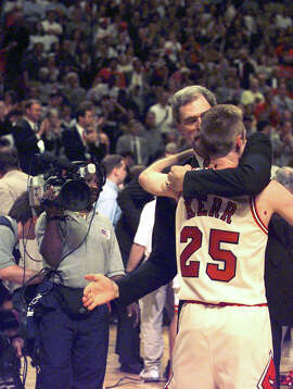 Shooting guard Steve Kerr gets a hug from Bulls head coach Phil Jackson after earning his second ring with Chicago. Kerr hit the winning 17-footer with five seconds left in Game 6.
