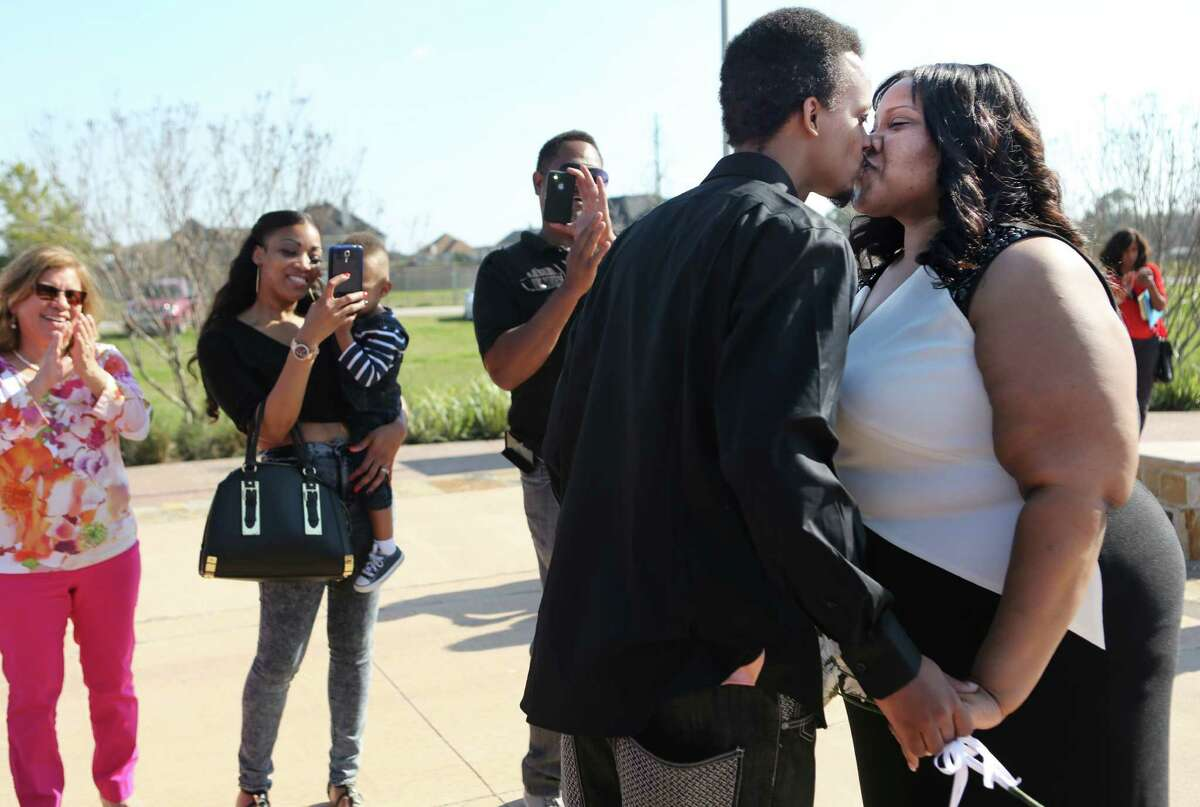 Wayne Variste, 35, and Charis Phillips, 34, have their first kiss as husband and wife on Valentine's Day at Current, a Christian Church, on Saturday, Feb. 14, 2015, in Houston. The couple lived together and have been wanting to get married.