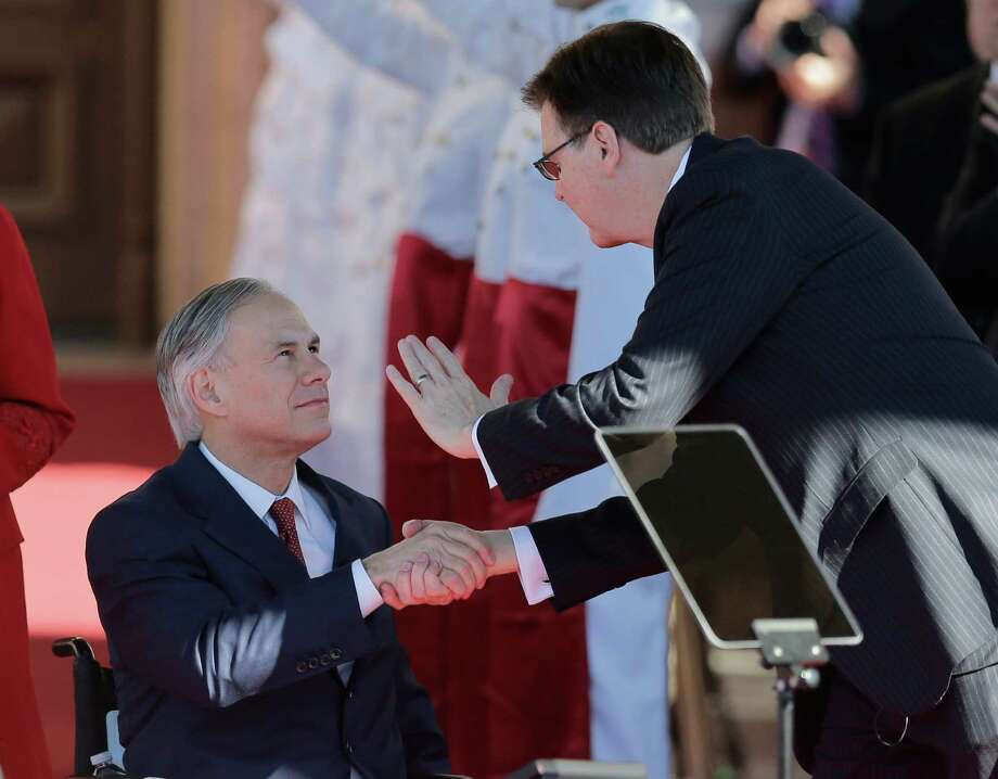 As a result of his hefty contribution, according to a reader, an unvetted donor who pleaded to assault gained access to Gov. Greg Abbott, left, and Lt. Gov. Dan Patrick, shown here during their recent inauguration. Photo: Eric Gay /Associated Press / AP