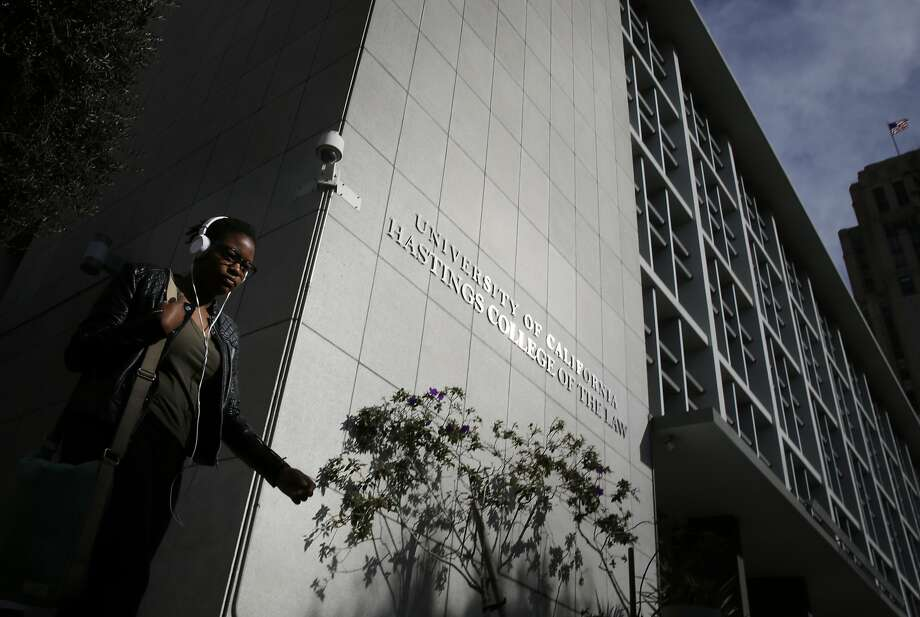 Jordan Bosse, of San Francisco, walks past  UC Hastings main building at 198 McAllister Street on Tuesday Feb. 10, 2015 in San Francisco, Calif,  There is a three part proposal to improve the campus which would include this building a vacant lot at 333 Golden Gate Avenue and 100 McAllister. Photo: Mike Kepka, The Chronicle