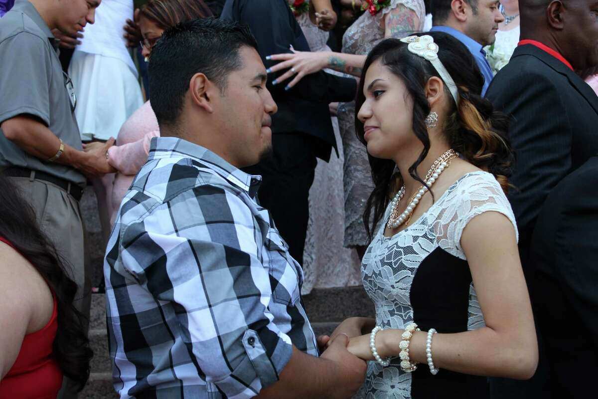 Love was in the air and on the steps of the Bexar County Courthouse on Valentine's Day as many San Antonio couples tied the knot during an annual mass wedding ceremony.
