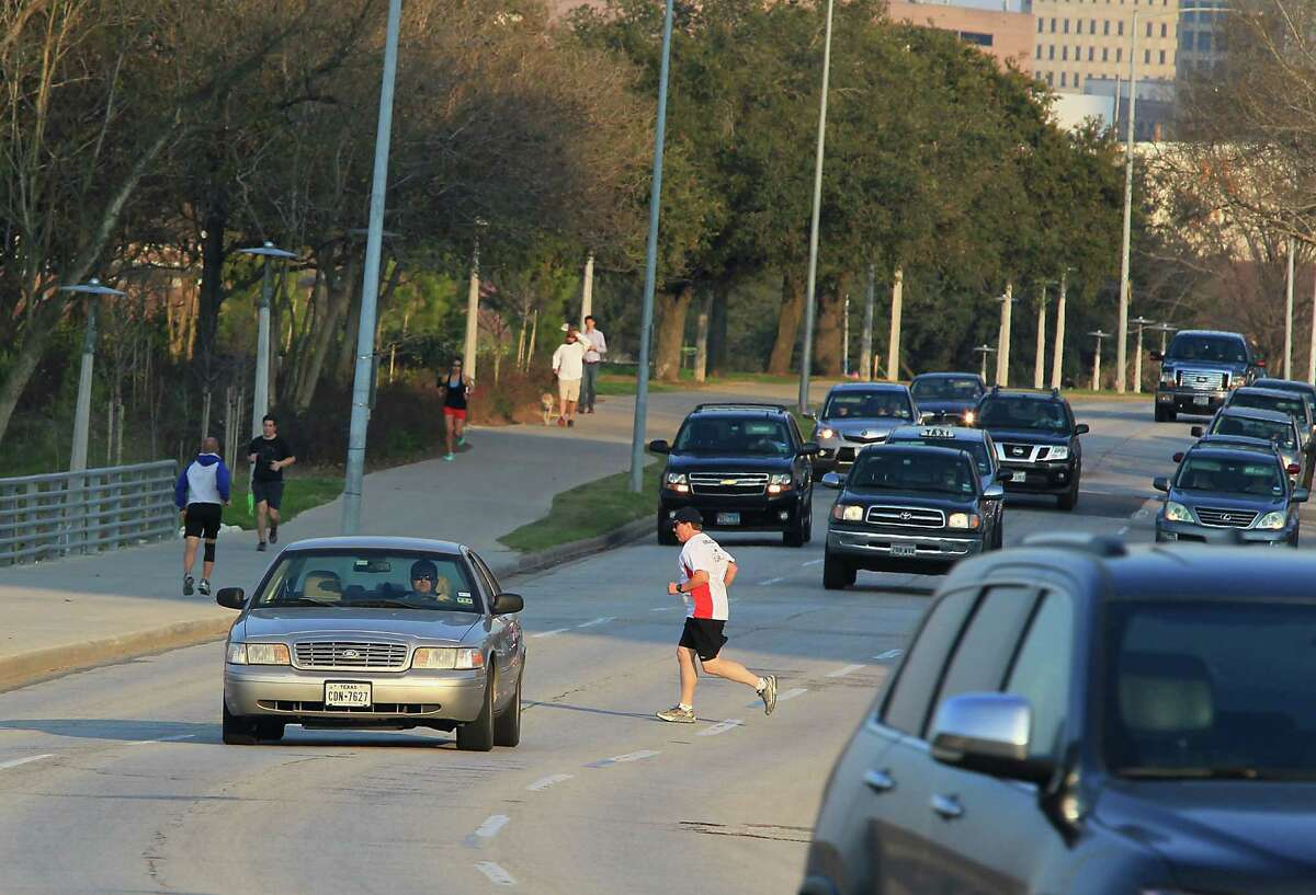 Pat Dunnahoo jogs across Allen Parkway near Taft Street on July 25, 2015. The recent changes were intended to eliminate the risky crossings.