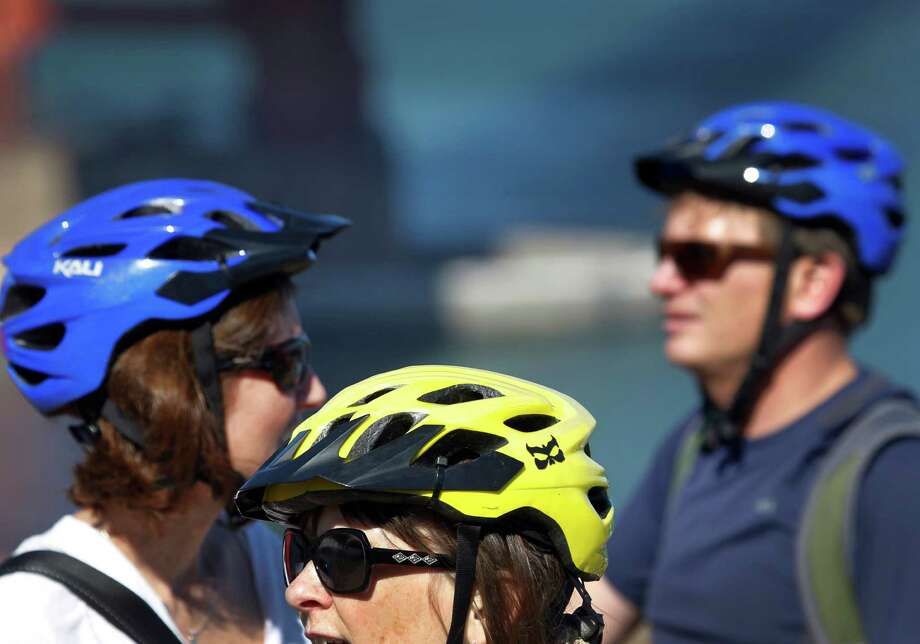 A bill has been introduced in the California Legislature that would make helmets mandatory for all bicycle riders, requiring adults to wear them in addition to minors. Photo: Paul Chinn / The Chronicle / ONLINE_YES