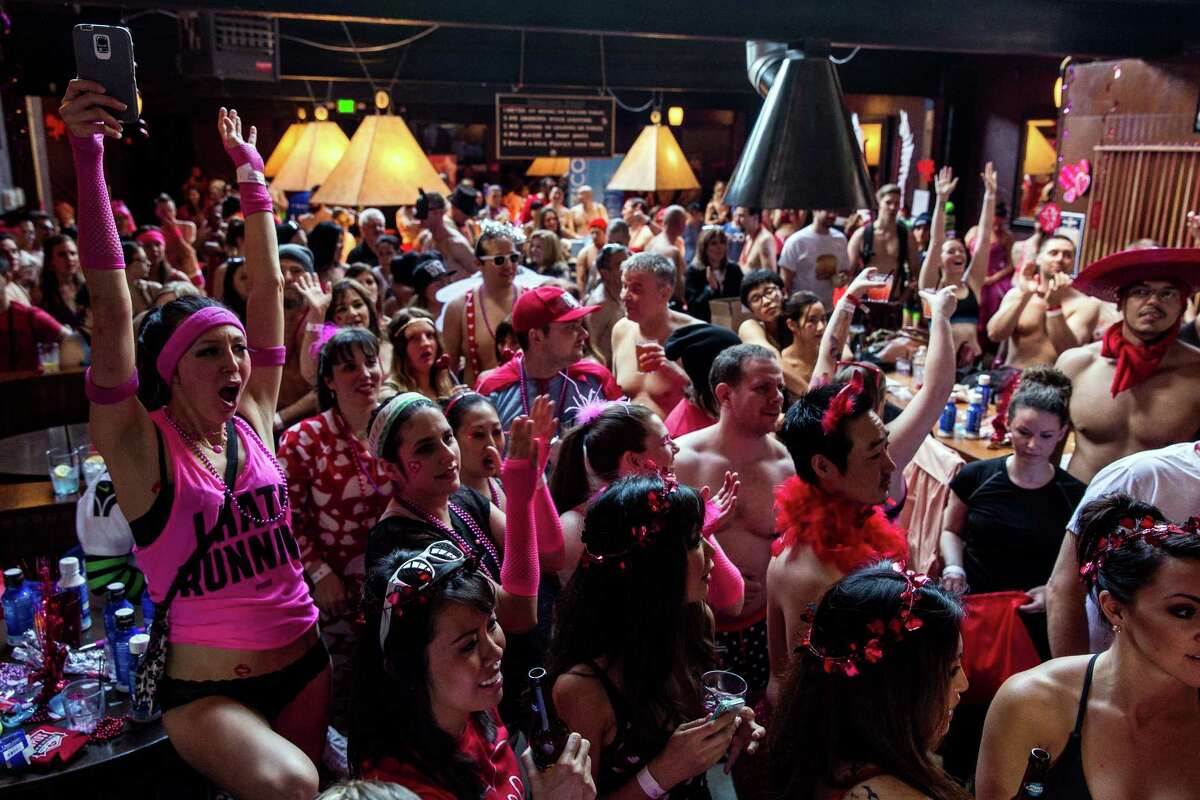 Hundreds of runners pack the bar before the annual Cupid's Undie Run Saturday, February 14, 2015, in Seattle's Fremont neighborhood. Hundreds of people gathered at the Ballroom and then completed a roughly mile-long run in their skivvies. The event was a fundraiser for The Children's Tumor Foundation.