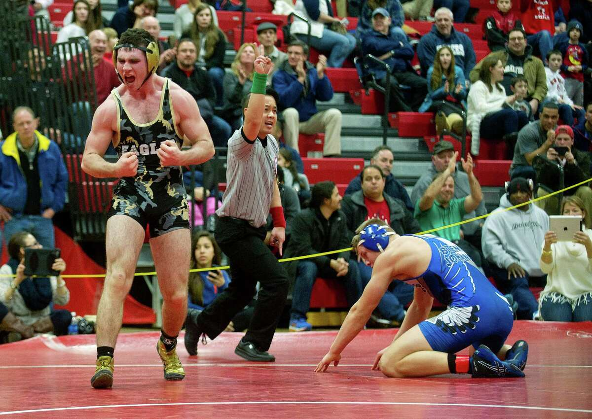 Joey Ryan of Trumbull celebrates his win over Lee Stenild Johansen of Fairfield Ludlowe during Saturday's FCIAC wrestling championship finals at New Canaan High School on February 14, 2015.