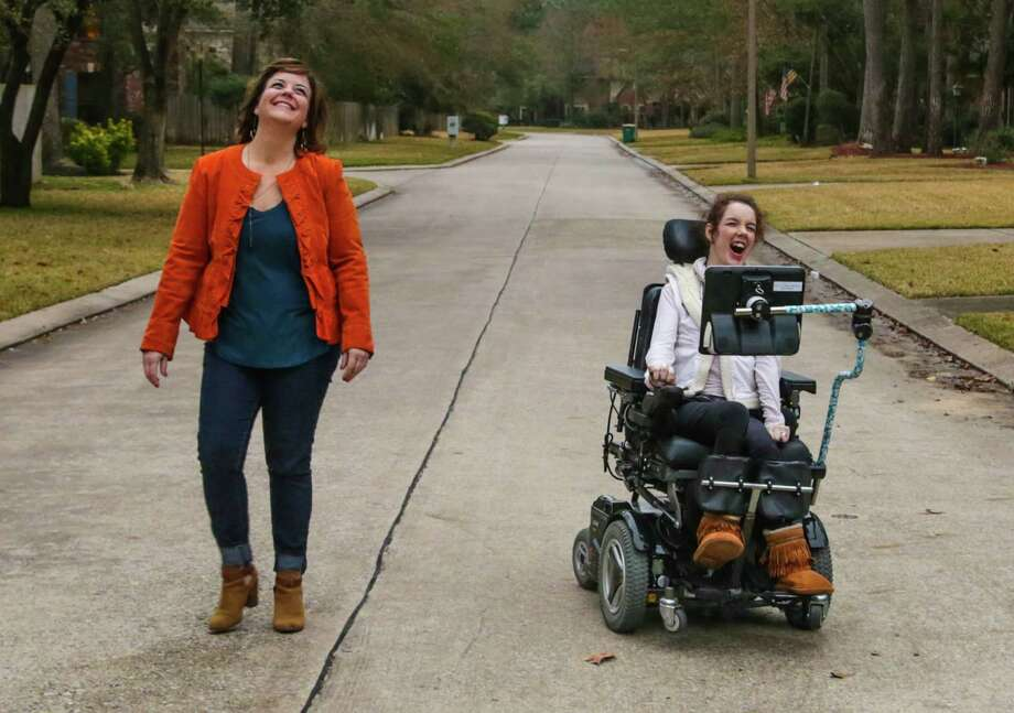 Being diagnosed with cerebral palsy causes many restrictions for 16-year-old Megan Fry. She and her mother, Andrea, think access to a public transportation system would allow her the independence she desires. Photo: Billy Smith II, Staff / Houston Chronicle