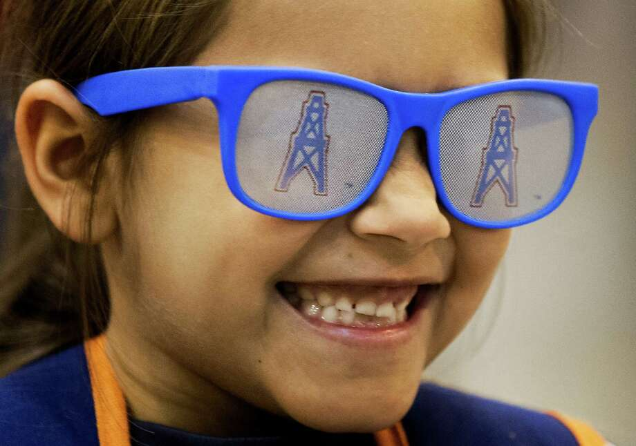 Laurissa Lopez,7, wears a pair of Houston Oilers' glasses as she walks around the Tristar autograph show at NRG park on Saturday, Feb. 14, 2015, in Houston. Photo: J. Patric Schneider, For The Chronicle / © 2015 Houston Chronicle