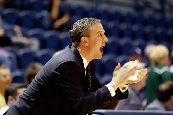 Rice assistant basketball coach Scott Pera, shown at Saturday's game against UAB, coached Rockets All-Star James Harden in high school in California.