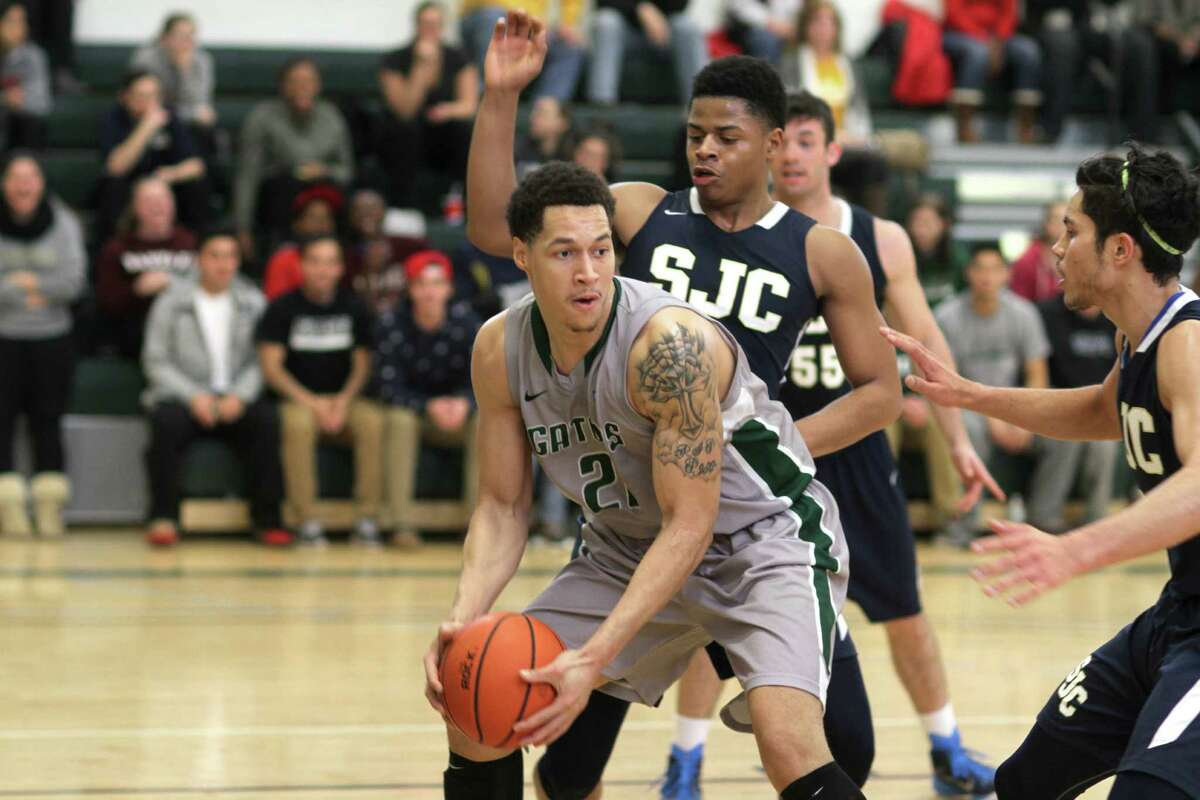 Kai Deans of Sage men's basketball makes a move to the basket against St. Joseph's. (Courtesy The Sage Colleges)