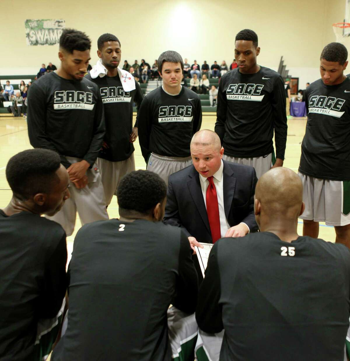 Sage men's basketball coach Brian Barnes talks to his team. (Courtesy The Sage Colleges)