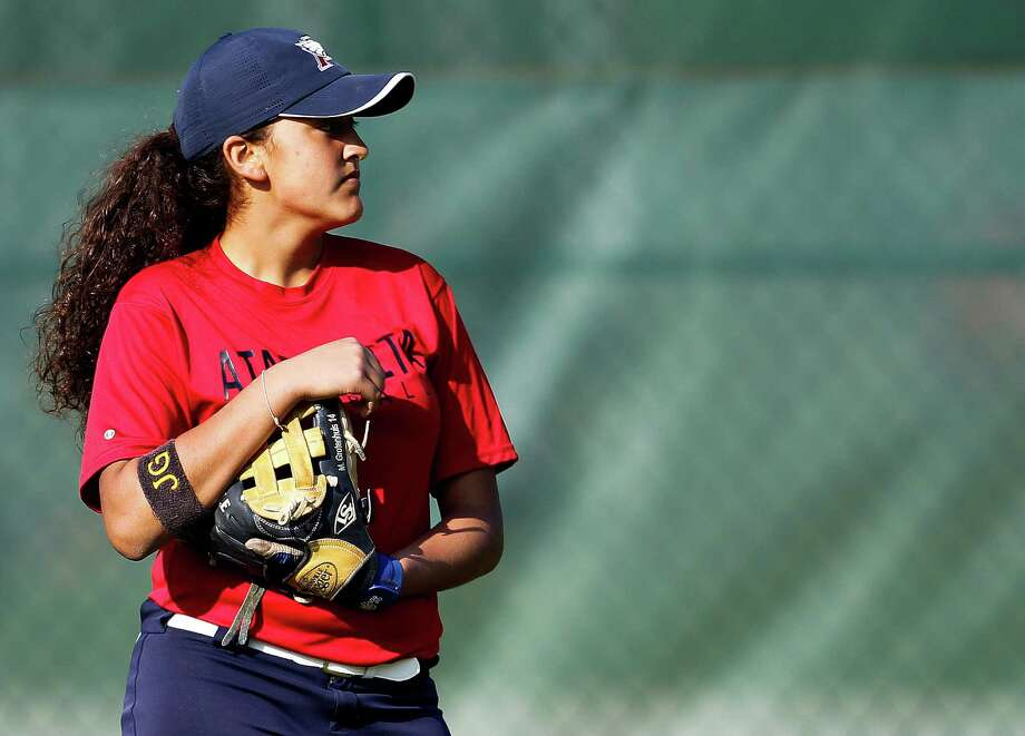 Lillian Grotenhuis, 14, dreamed of playing softball at Atascocita High School for her dad, James, who died last summer. Now an outfielder for the team, Lillian is learning to play through the pain of grief.  Photo: Karen Warren, Staff / © 2015 Houston Chronicle