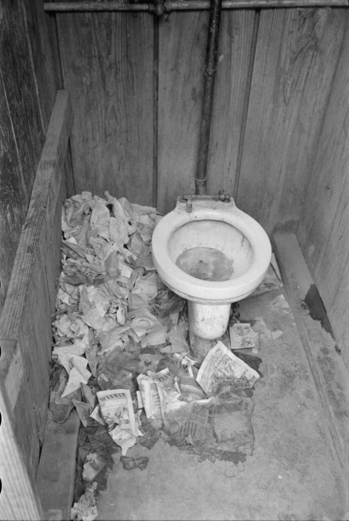 """This 1939 photo, labeled """"Interior of privy in corral, Mexican district, San Antonio"""" by photographer Russell Lee shows the unsanitary conditions some San Antonians lived with in the 1930s. Farm Security Administration - Office of War Information Photograph Collection."""