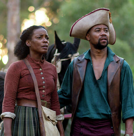 """This image released by Entertainment One/BET shows Aunjanue Ellis, left, and Cuba Gooding Jr. in a scene from """"The Book of Negros,"""" a six-part miniseries starting Monday Feb. 16, at 8PM ET/PT. (AP Photo/Entertainment One/BET, Joe Alblas) Photo: Joe Alblas / Associated Press / Entertainment One/BET"""