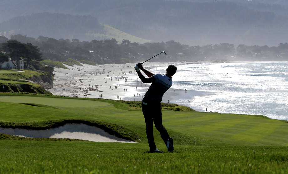 Dustin Johnson, swinging on No. 8 at Pebble Beach, made the cut in his second tourney back from a leave. Photo: Michael Macor / The Chronicle / ONLINE_YES