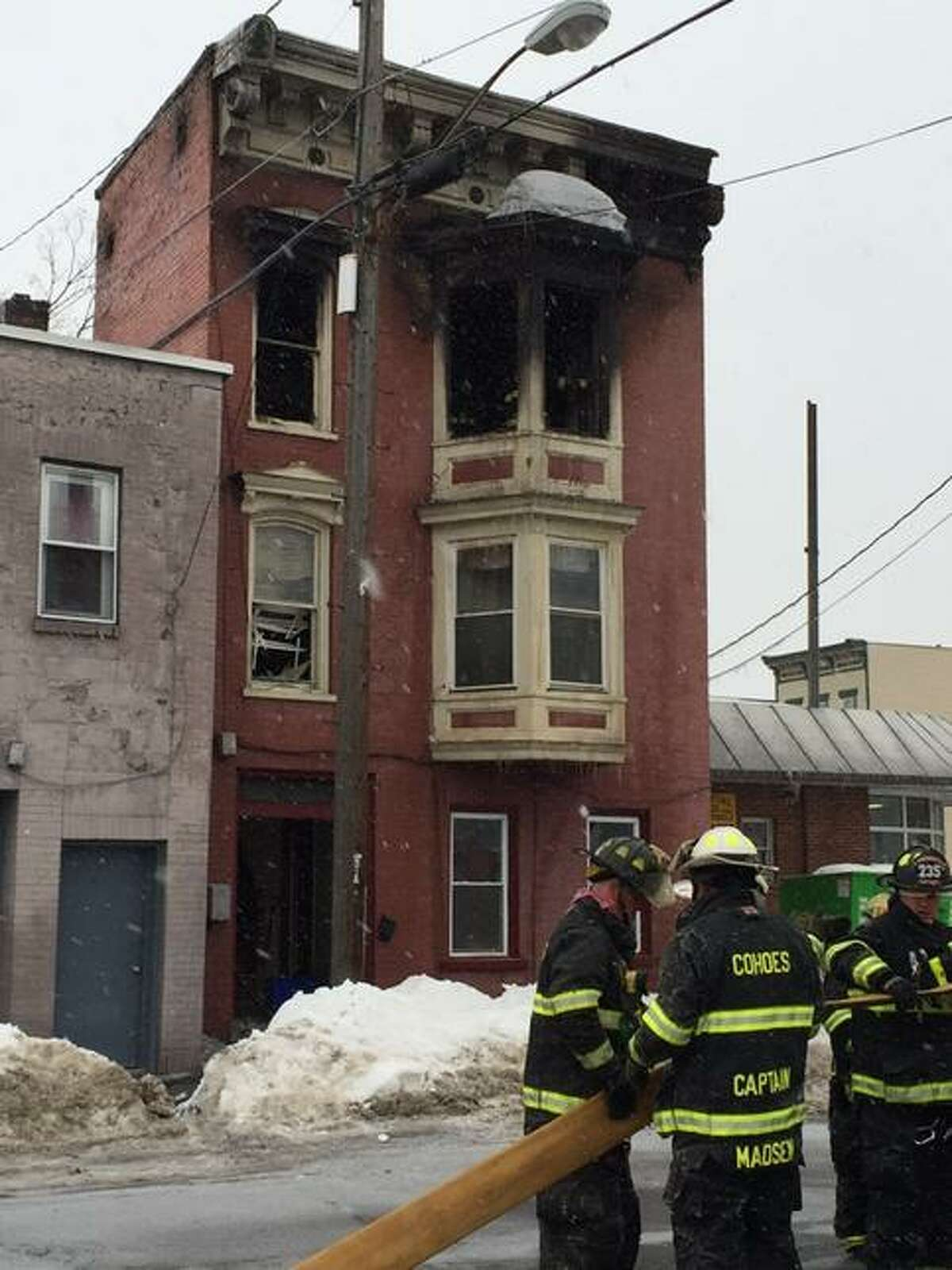 A fire tore through the vacant third floor of 23 Columbia St. in Cohoes on Saturday, Feb. 14, 2015. A second floor tennant and his dog escaped unharmed. (Jordan Carleo-Evangelist/Times Union)
