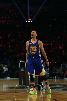 Stephen Curry lets out a scream during his Three-Point Contest victory. Curry hit 20 of 25 shots in the finals for a contest record 27 points, defeating Klay Thompson and Kyrie Irving.