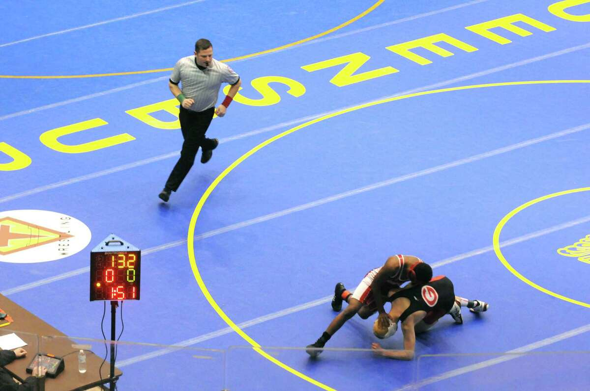 High school wrestlers hit the mats during the Section II Wrestling Championships at the Glens Falls Civic Center on Saturday Feb. 14, 2015 in Glens Falls, N.Y. (Michael P. Farrell/Times Union)