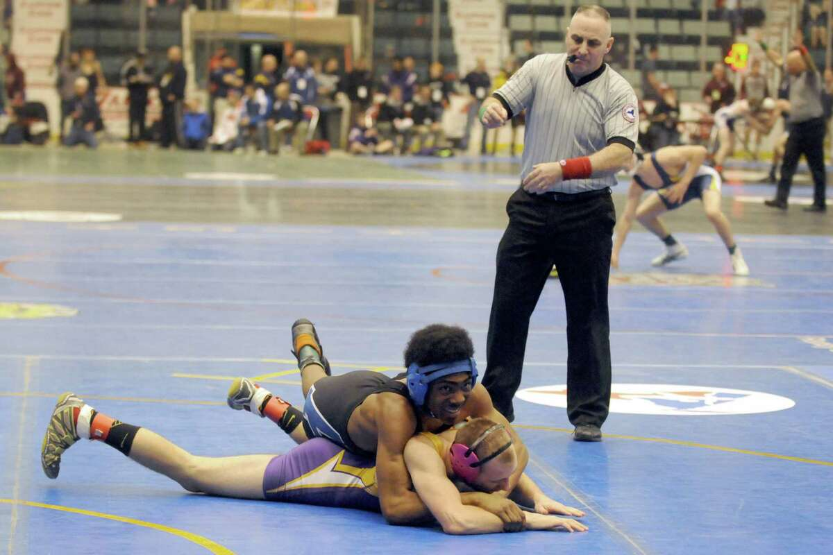 Albany High School's Miles Jackson and Ballston Spa's Corey LaQue compete in the 138lbs. class during the Section II Wrestling Championships at the Glens Falls Civic Center on Saturday Feb. 14, 2015 in Glens Falls, N.Y. (Michael P. Farrell/Times Union)