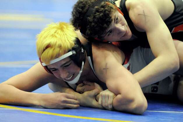 Mohonasen Kyle Gardener, left, and Guilderlands Tyler Grupe compete in the 132lbs. class during the Section II Wrestling Championships at the Glens Falls Civic Center on Saturday Feb. 14, 2015 in Glens Falls, N.Y. (Michael P. Farrell/Times Union) Photo: Michael P. Farrell / 00030612A