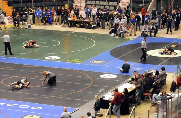 High school wrestlers hit the mats during the Section II Wrestling Championships at the Glens Falls Civic Center on Saturday Feb. 14, 2015 in Glens Falls, N.Y. (Michael P. Farrell/Times Union) Photo: Michael P. Farrell / 00030612A